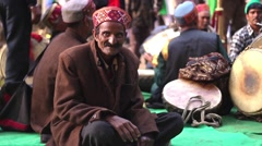 Old Hindu man sits in front of traditional musicians. Stock Footage