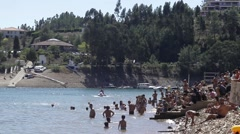 Wakeboard and bathers in river beach - Zezere,Portugal Stock Footage