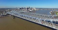 Stationary aerial shot of the Crescent City Bridge over the Mississippi River Stock Footage
