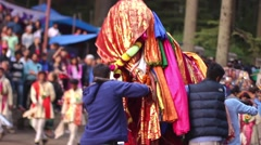 Worshippers carry a god on a palanquin during a Hindu fesitval Stock Footage