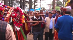 Worshipers carry a god on a palenquin during a fesitval for the goddess Hadimba Stock Footage
