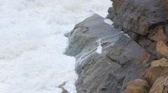 Slow Motion shot huge ocean waves on coastline in a storm Stock Footage