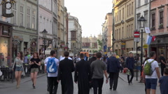 WYD Krakow 2016 - Crowd (teenagers, priest, vicar) in street - summer sunset Stock Footage