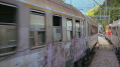 Passenger trains passing each other on the rails in the rural environment Stock Footage