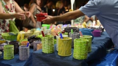 The sale in an evening summer market Stock Footage