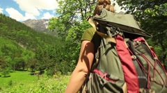 Young woman hiker walks in beautiful Himalayan landscape. Tracking shot Stock Footage