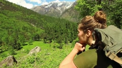 Young woman looks out over beautiful Himalayan landscape. Tracking shot past Stock Footage