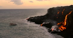 Tourist looking at Volcanic Eruption Lava flowing into the ocean Stock Footage