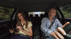 The funny boy dancing in the car and girl using the tablet. 4K Stock Footage
