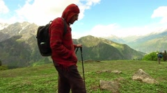 Male hiker walks past camera before amazing Himalayan mountain landscape Stock Footage