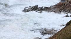 Slow Motion shot of huge ocean waves on the coastline in a storm Stock Footage