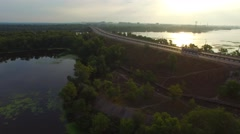 Aerial view of the bridge over a large river Stock Footage