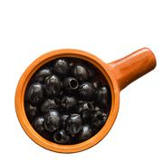 Olives in ceramic ware, on a white background Stock Photos