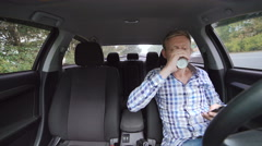 Man drinking coffee and using phone, girl sitting into car with tablet. 4K Arkistovideo