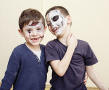 Zombie apocalypse kids concept. Birthday party celebration facepaint on children Stock Photos