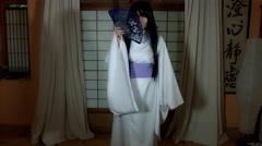 4k Anime Shot of a Japanese Woman Geisha with a Purple Fan, long shot Stock Footage