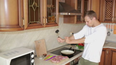 Man Beats Meat By Kitchen Hammer, funny guy dancing and preparing food Stock Footage