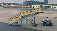 Düsseldorf 1962: vehicle moving the aircraft staires Stock Footage