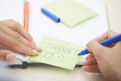 Thanks on adhesive note Stock Photos