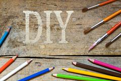 Wooden background with the word diy Stock Photos