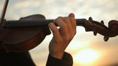 Violin. Violinist playing at sunset. Strings and bow Stock Footage