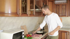 Man Beats Meat By Kitchen Hammer, fighter punches meat Stock Footage