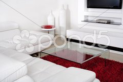 Living space with white leather couch Stock Photos