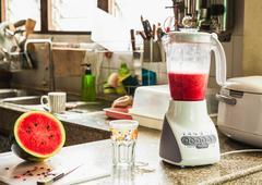 Eletric juice blender machine and watermelon Stock Photos