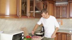 Man Beats Meat By Kitchen Hammer. man preparing dinner Stock Footage