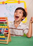 Boy with abacus screaming loudly Stock Photos