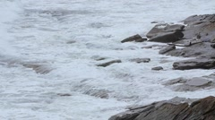 Slow Motion shot of ocean waves on coast in a storm Stock Footage