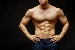 Handsome young man's torso Stock Photos