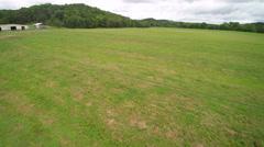 Empty field headed towards barn Stock Footage