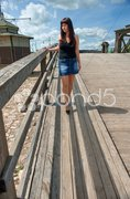 Beauty girl on the old-time bridge. Stock Photos