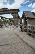 Beauty girl on old-time bridge. - stock photo