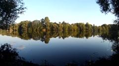 Calm pond in a village with sudden ripples. Ukraine, Khmelnytskyi, Podillya Stock Footage