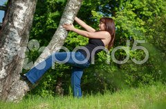 Young woman with tree. - stock photo