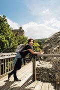 Young traveller woman posing in castle ruins of Hainburg an der Donau, Austri Stock Photos
