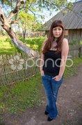 Beauty girl in farmstead. Stock Photos