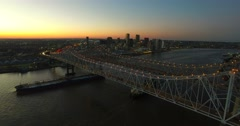 Beautiful night aerial shot of the Crescent City Bridge over the Mississippi Stock Footage