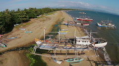 Aerial view on the traditional fisher boats and coast (Negros, Philippines) Stock Footage