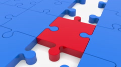 Puzzle pieces in blue color with one between red Stock Footage