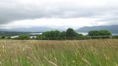 View to lake and farmland at connemara in ireland  54 Stock Footage