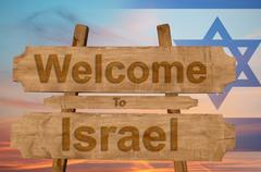 Welcome to Israel sing on wood background with blending national flag Stock Photos
