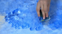 Hands holding a sponge and paint over the wall. Artist tool. Stock Footage