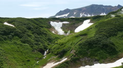 Older crater in valley of mutnovsky volcano kamchatka peninsula russia Stock Footage
