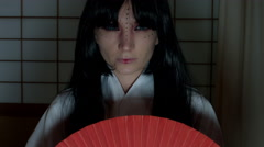4k Anime Shot of a Japanese Woman Geisha Posing with a Red fan, full face - stock footage