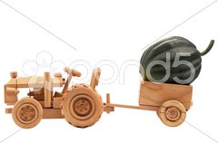 Toy tractor with green pumpkin. Stock Photos