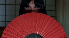 4k Anime Shot of a Japanese Woman Geisha Posing with a Red fan, Eyes only - stock footage