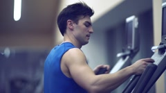 Athletic man on a treadmill Stock Footage